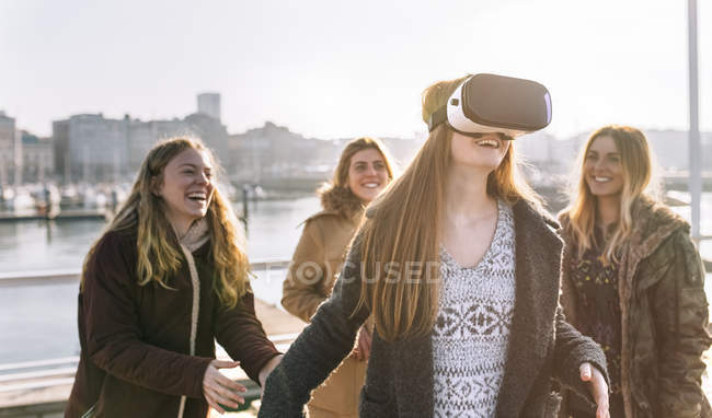Young women using VR glasses outdoors — Stock Photo