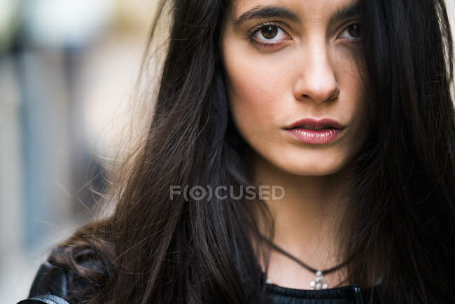 Young woman portrait looking at camera — Stock Photo
