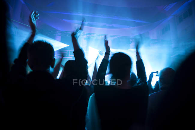 Crowd having fun at concert at dark — Stock Photo