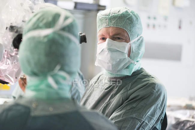 Portrait of two neurosurgeons during an operation — Stock Photo