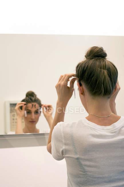 Woman testing glasses frames — Stock Photo