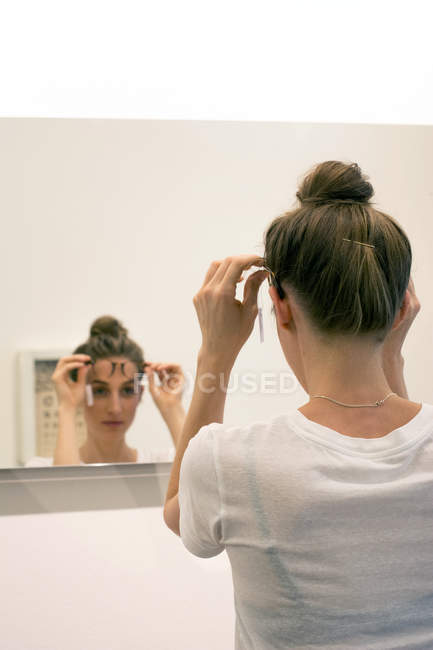 Woman testing glasses frames — Stock Photo