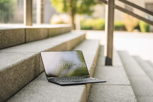 Daytime view of laptop placed on staircase — Stock Photo