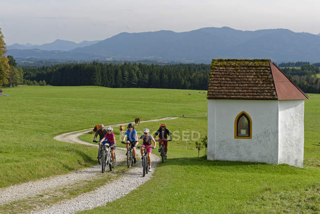 Germany, Bavaria, Faistenberg, family on a bicycle tour in countryside — Stock Photo