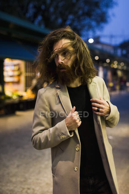 Man standing in city at night — Stock Photo