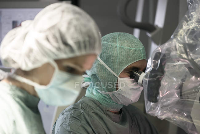 Neurosurgeon and operating room nurse during an operation — Stock Photo