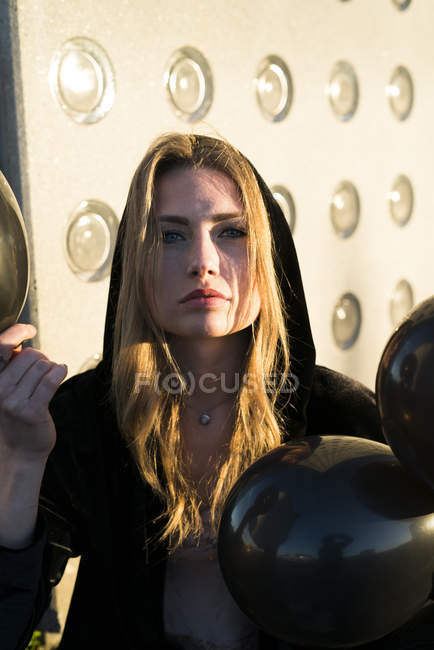 Portrait of young woman with air baloons — Stock Photo
