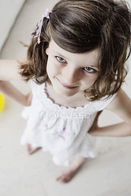 Cheaky little girl standing with hands on hips — Stock Photo