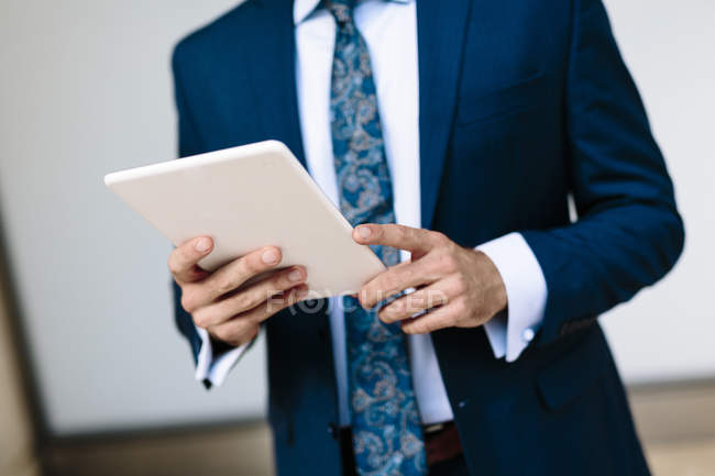 Businessman using digital tablet — Stock Photo