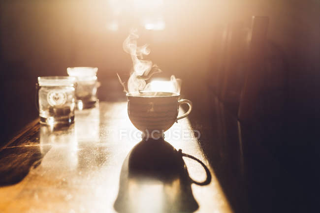 Hot cup of tea in morning light — Stock Photo