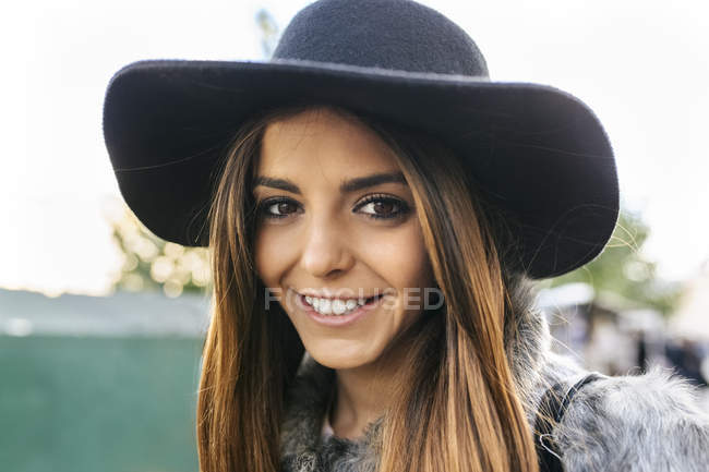 Portrait of young attractive woman in hat — Stock Photo