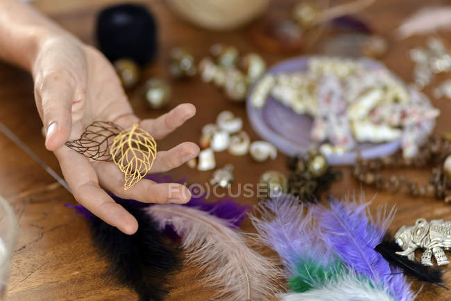 Female hand holding craft materials for handicraft — Photo de stock