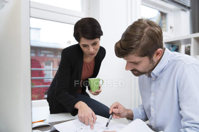 Team of professionals working together at modern office — Stock Photo