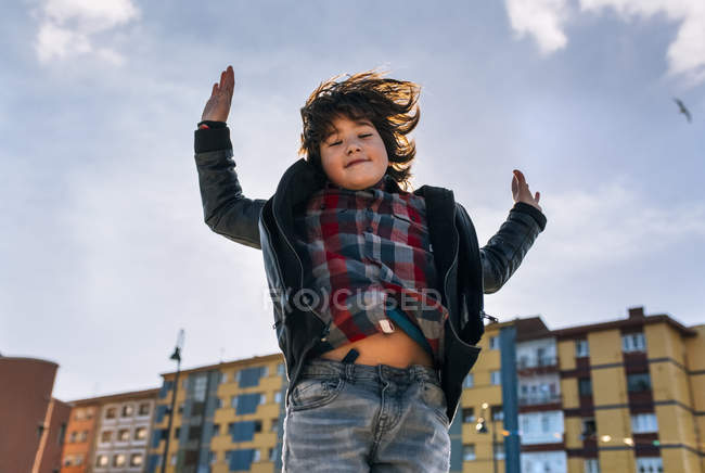 Cute little boy jumping in the air — Stock Photo