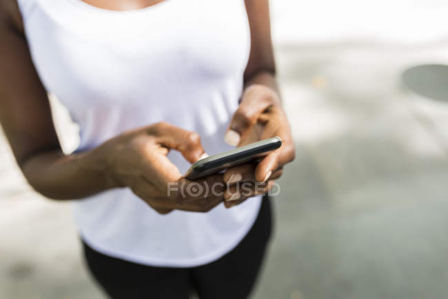 Cropped portrait of woman using smartphone — Stock Photo