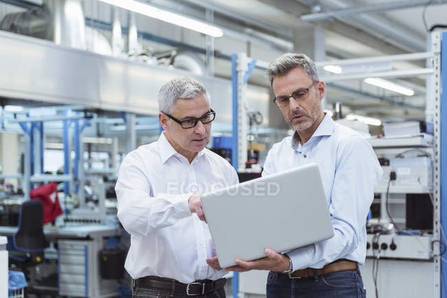 Managers standing in company — Stock Photo