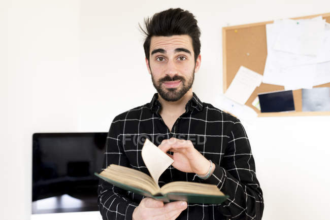 Man leafing pages of book — Stock Photo