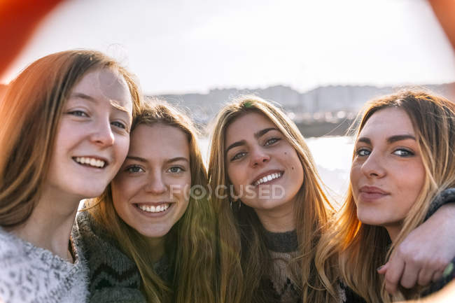 Four young women making a selfie in city — Stock Photo