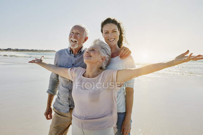 Portrait of smiling senior couple with adult daughter — Stock Photo