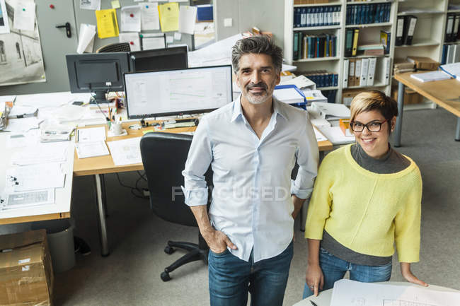 Portrait of Male and female architects standing in office — Stock Photo