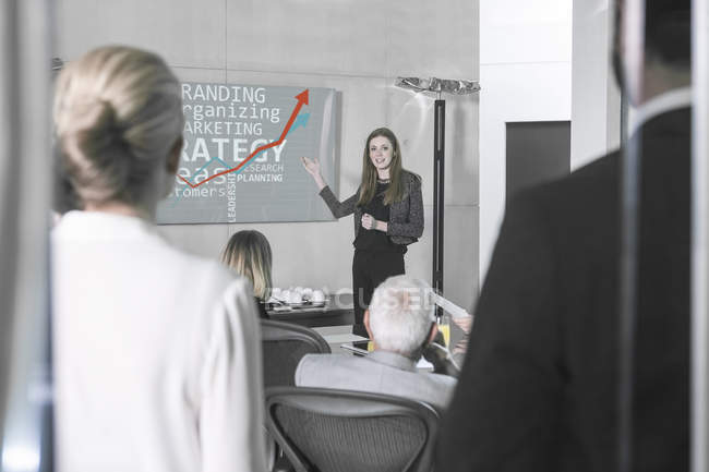Businesswoman holding presentation in front of team — Stock Photo