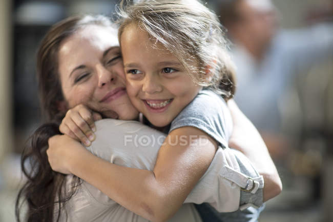 Portrait of Mother and daughter cuddling and embracing — Stock Photo