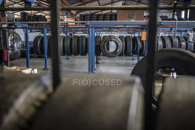 Daytime view of tires in a row on repair factory — Stock Photo