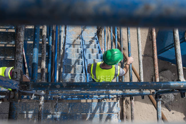 Construction worker on a construction site, overhead view — Stock Photo