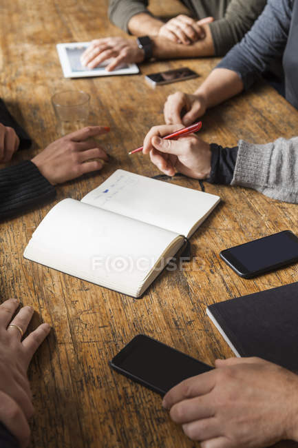 Coworkers working on a project on wooden table — Stock Photo
