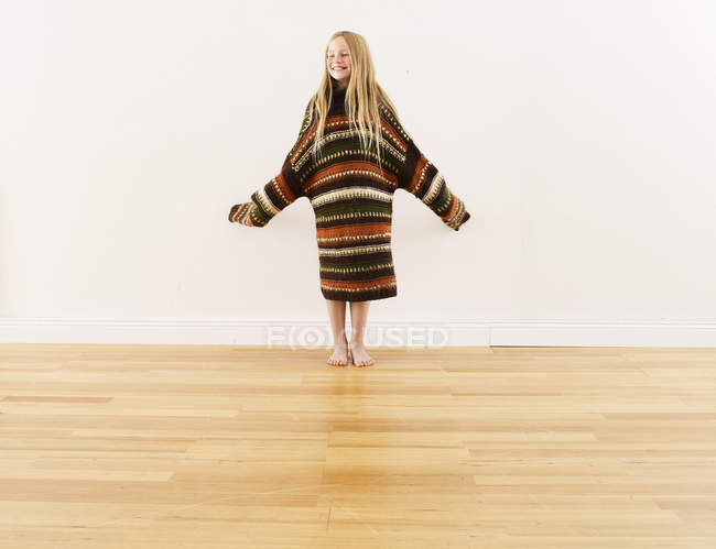 Girl wearing oversized knit pullover — Stock Photo