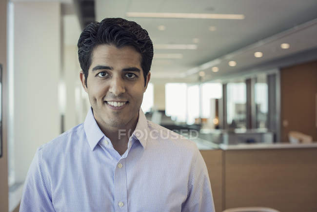 Portrait of Indian businessman standing in office — Stock Photo