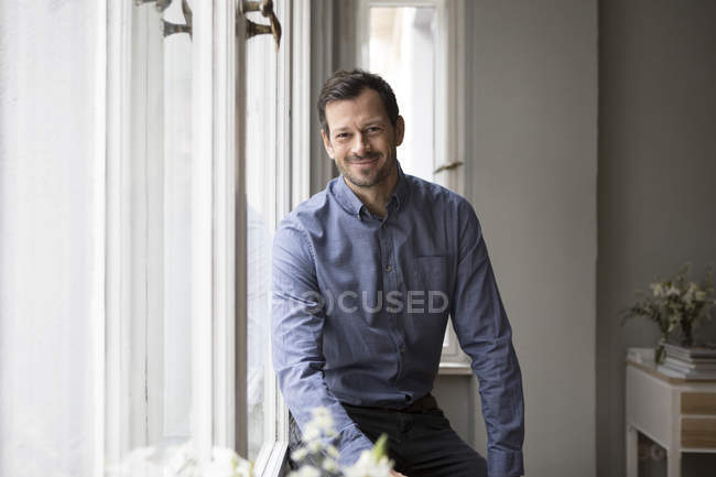 Portrait of handsome adult man at home — Stock Photo