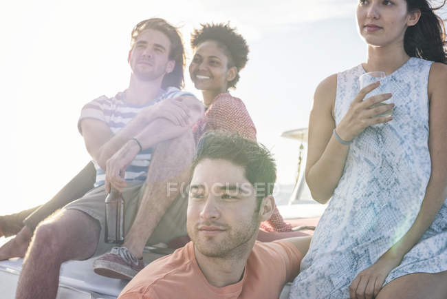 Friends on a boat trip having drinks — Stock Photo