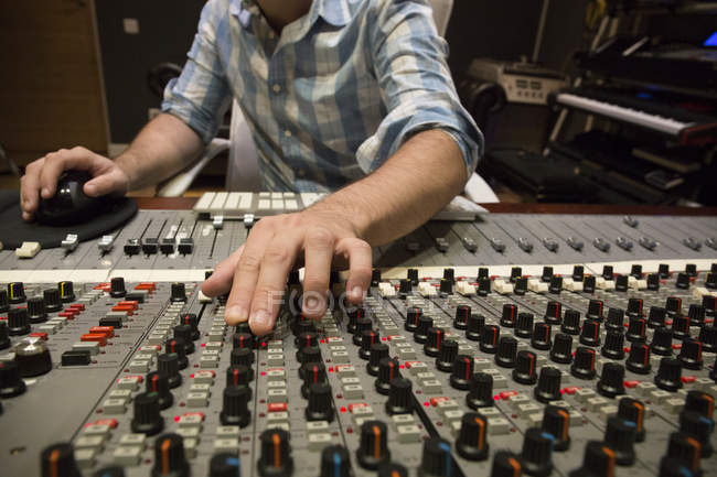 Hand of a man working in the control room of a recording studio — Stock Photo