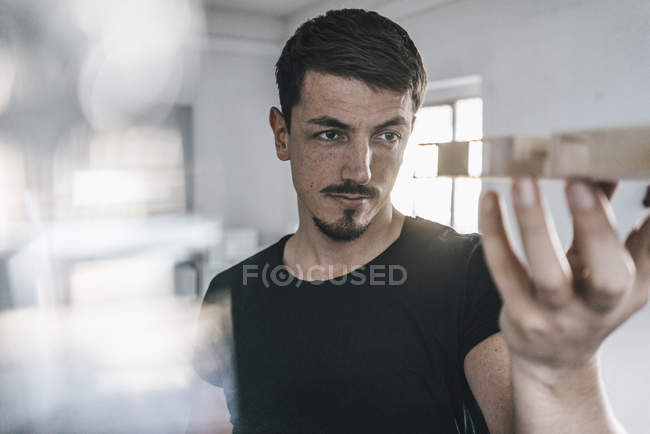 Close-up of Architect looking at architectural model — Stock Photo