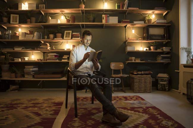 Man reading book at stylish home — Stock Photo