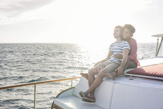 Happy young couple on a boat trip — Stock Photo