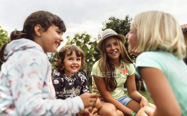 Group of four little girls having fun outdoors — Stock Photo