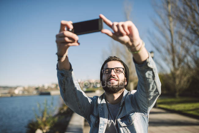 Casual young man taking a selfie outdoors, Ferrol, Galicia, Spain — Stock Photo