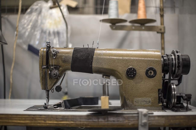 Sewing machine in tailor's workshop — Stock Photo