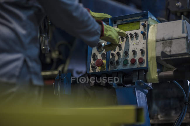 Close-up of workers hand on a control panel in factory — Stock Photo