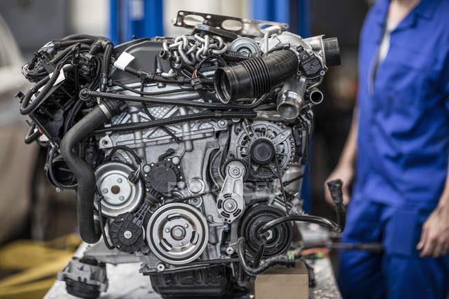 Closeup view of car engine in a workshop — Stock Photo