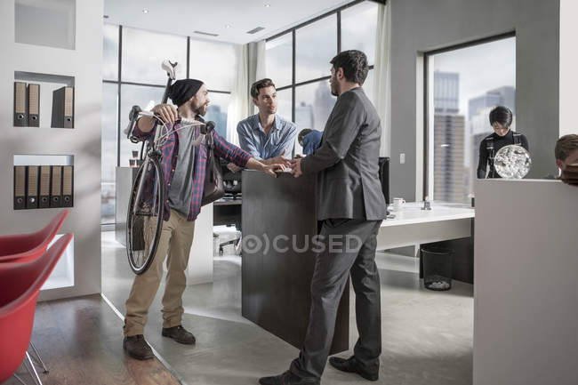 Business man shaking hands with clients in city office environment — Stock Photo