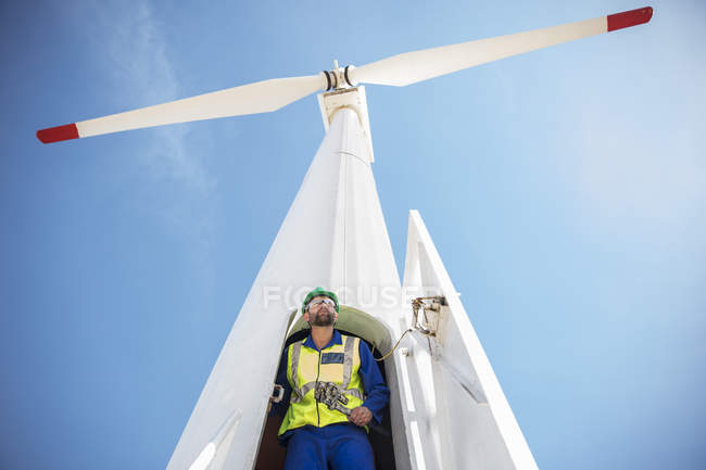 Engineer inspecting wind turbine, using wrench — Stock Photo