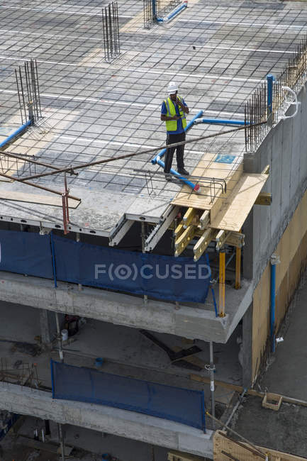 Worker standing on construction site — Stock Photo