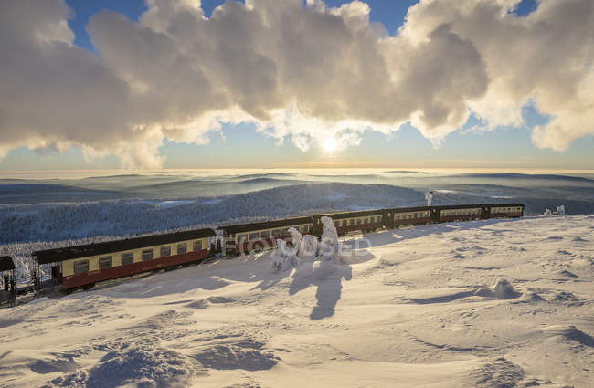 View of snow field under clouds and train on background — Stock Photo