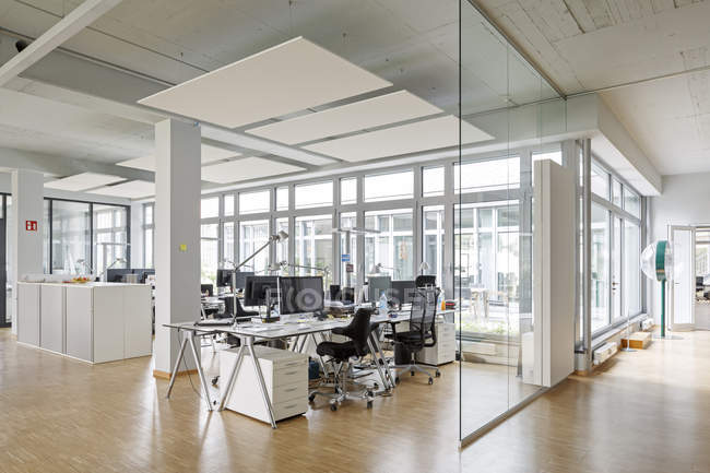 Empty office interior with glass wall — Stock Photo