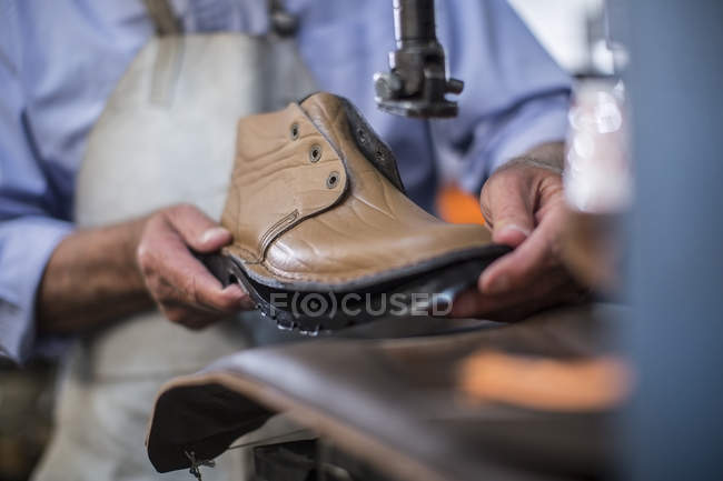 Shoemaker working on shoe in workshop, closeup — Stock Photo