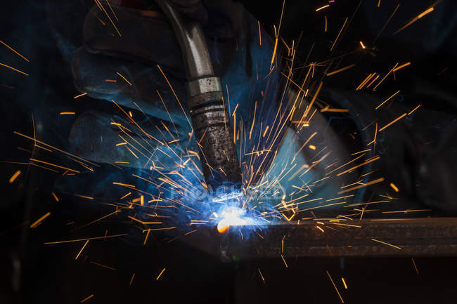 Close-up of protective glove and welding torch — Stock Photo