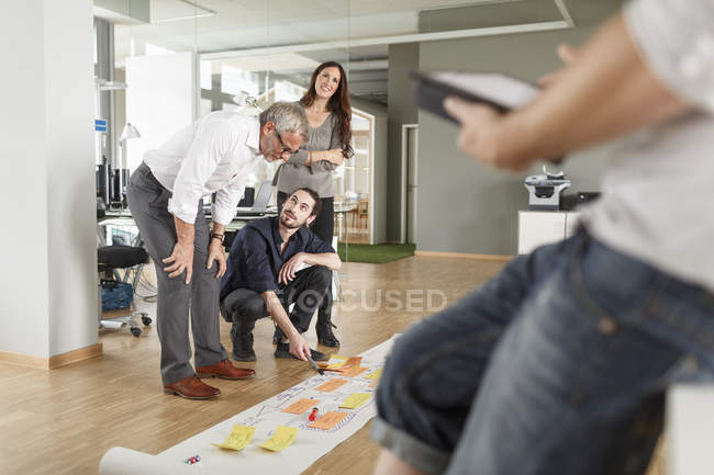 Creative professional presenting project in modern office — Stock Photo